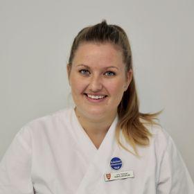 Portrett av tannhelsesekretær Julie Pettersen.