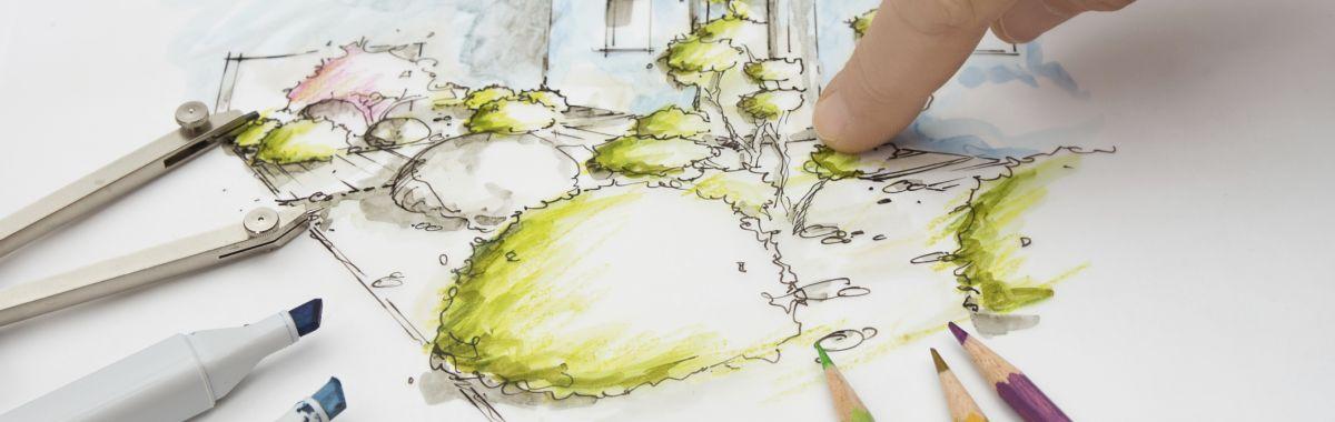 Arealplanlegger ser på tegning