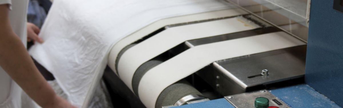 Rullepresse på vaskeri